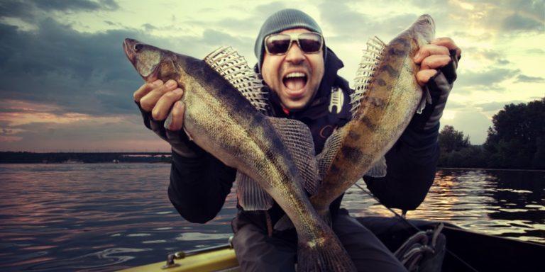 Happy man holding his catch