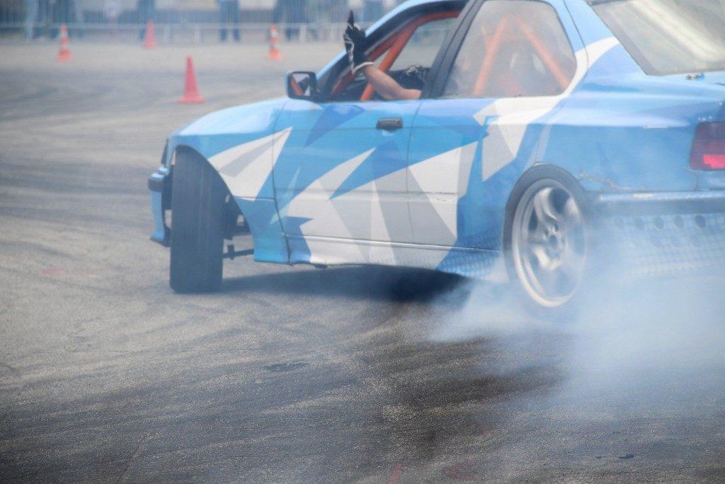 blue race car drifting