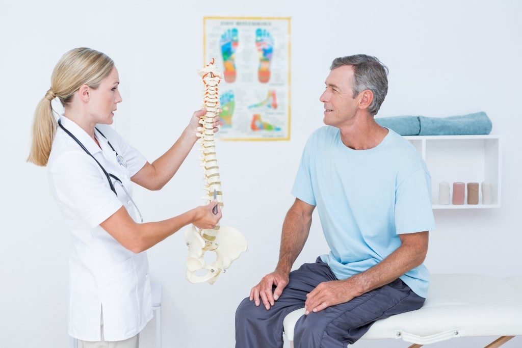 Cervical spine being explained to man