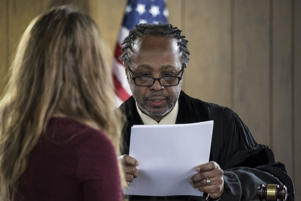judge reading a document