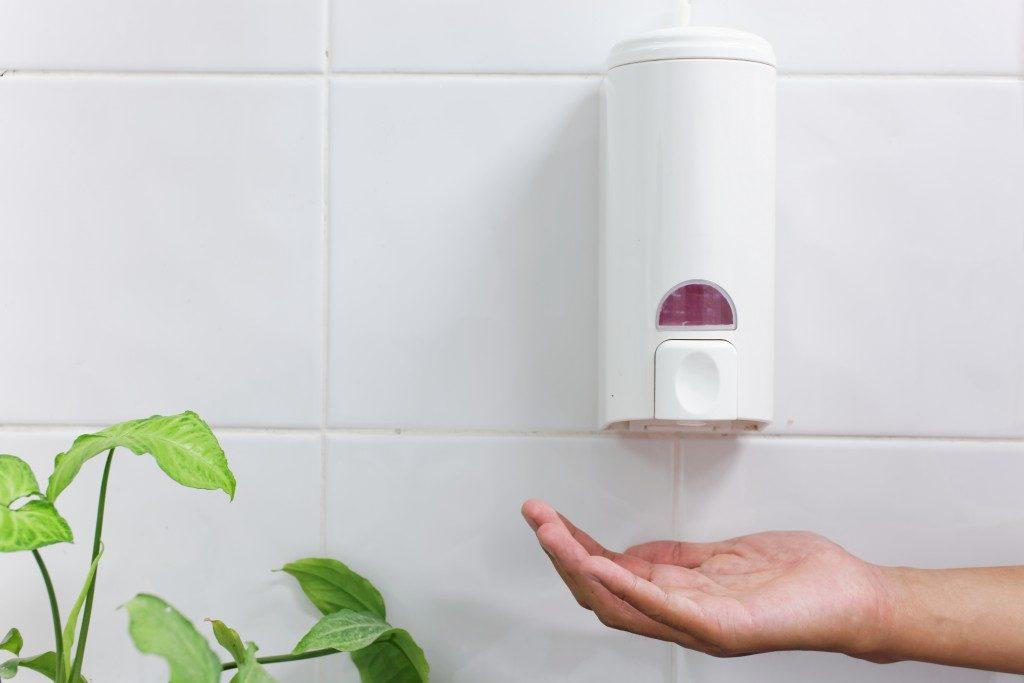hand getting hand sanitizer