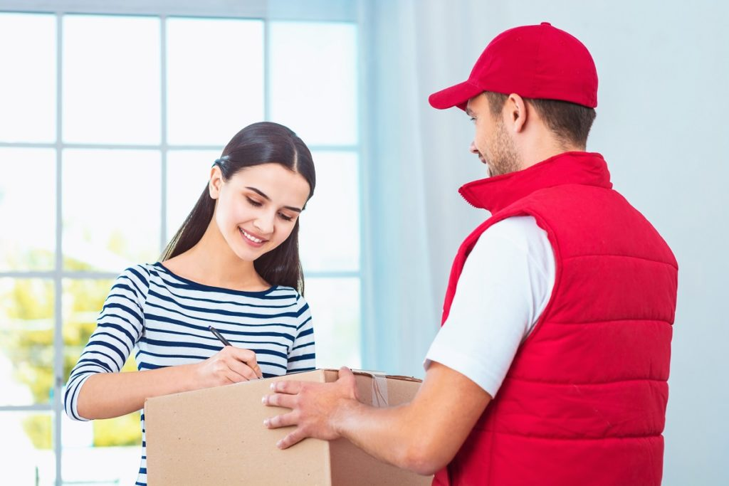 delivery of package, woman signing paper