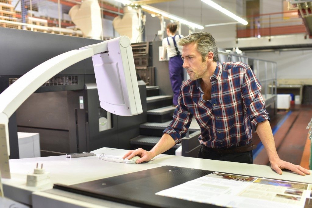 man in his printing business