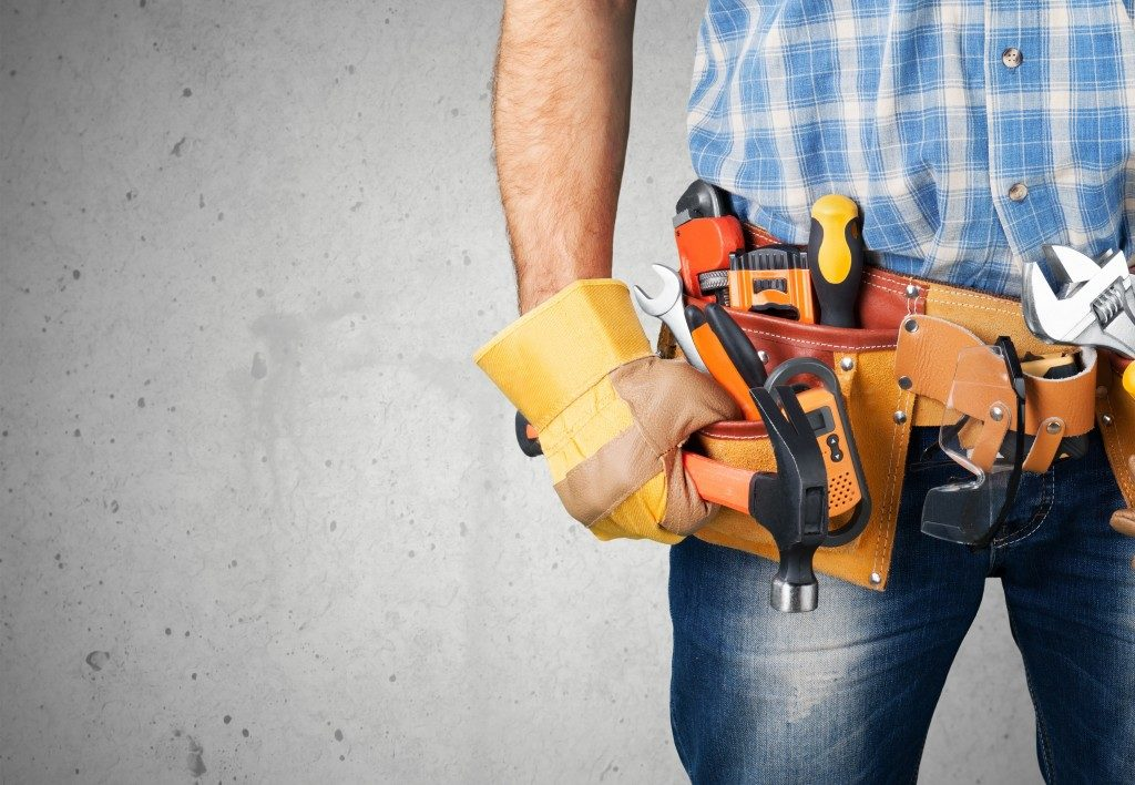 man posed with a tool belt