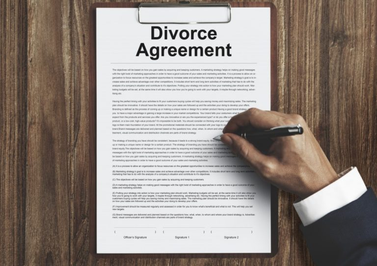 Divorce agreement form being signed