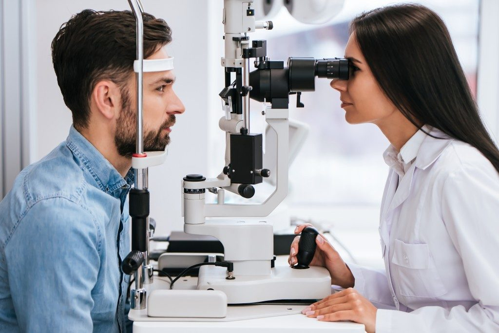 eye doctor examining a patient