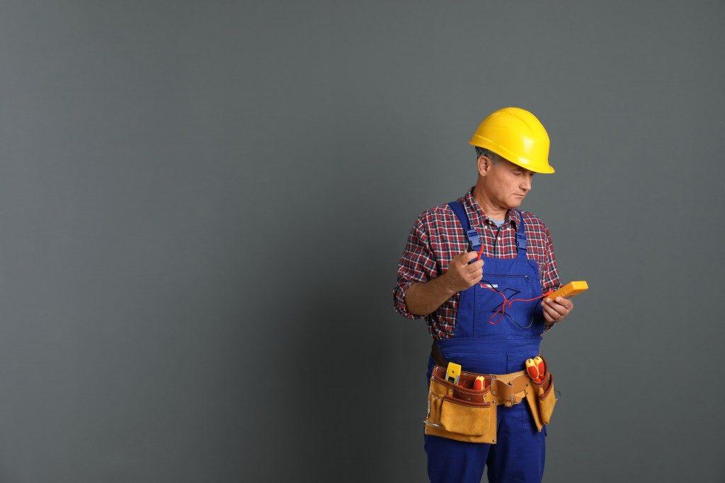Maintenance man on grey background