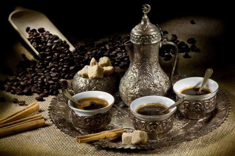 Turkish coffee pot with hot coffee