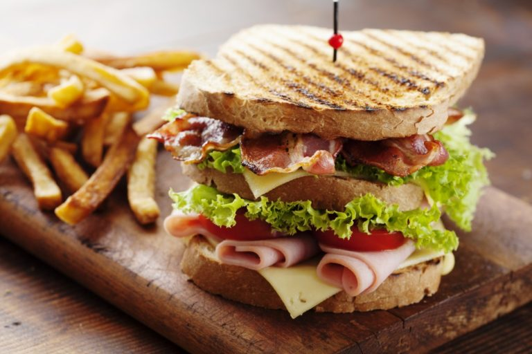 Club sandwich served with fries