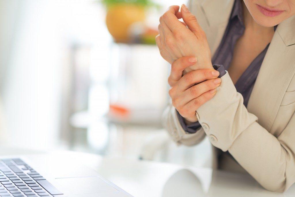 woman suffering from arthritis