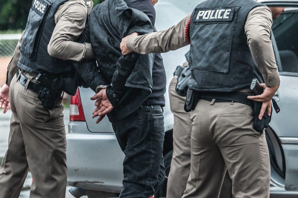 Man arrested by policemen