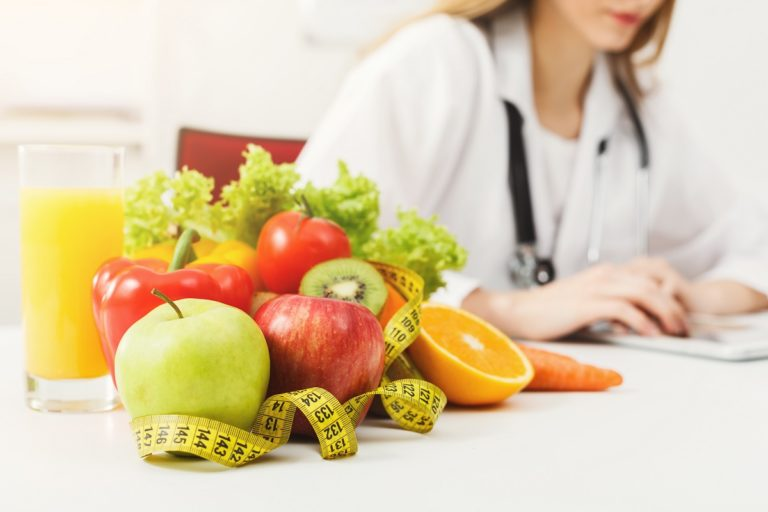 dietitian with fruits and veggies