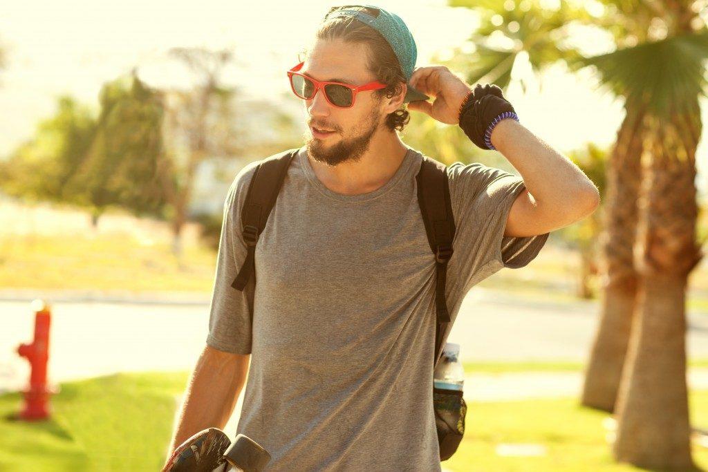 man in plain shirt and sunglasses