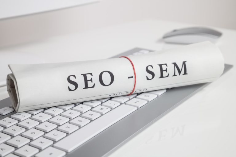seo and sem printed in a rolled paper