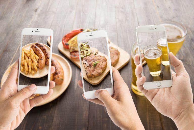 people taking photos of food