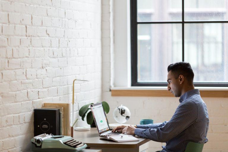 man on his computer