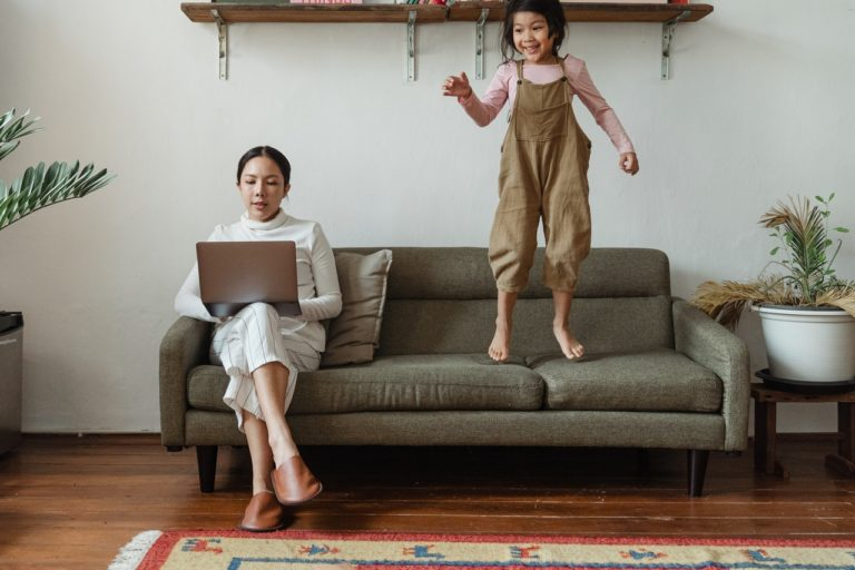 woman working from home with her daughter