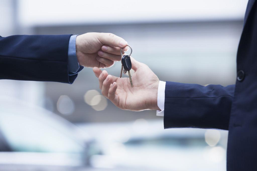 handing over the car keys