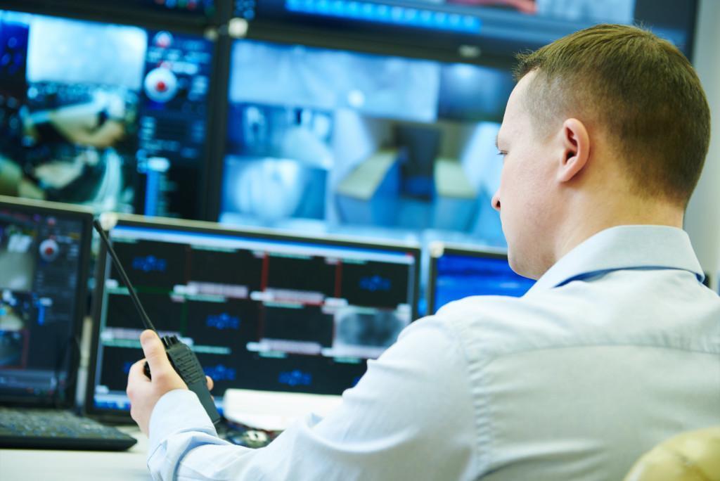 man monitoring security camera feed