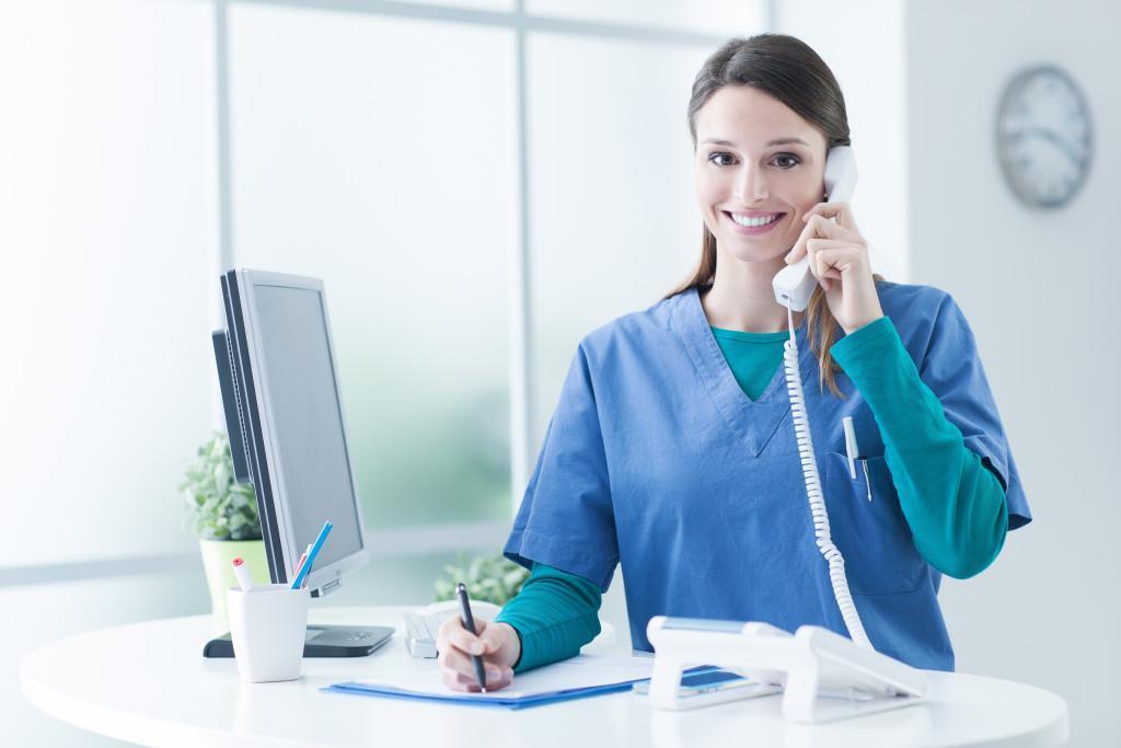 health worker using phone