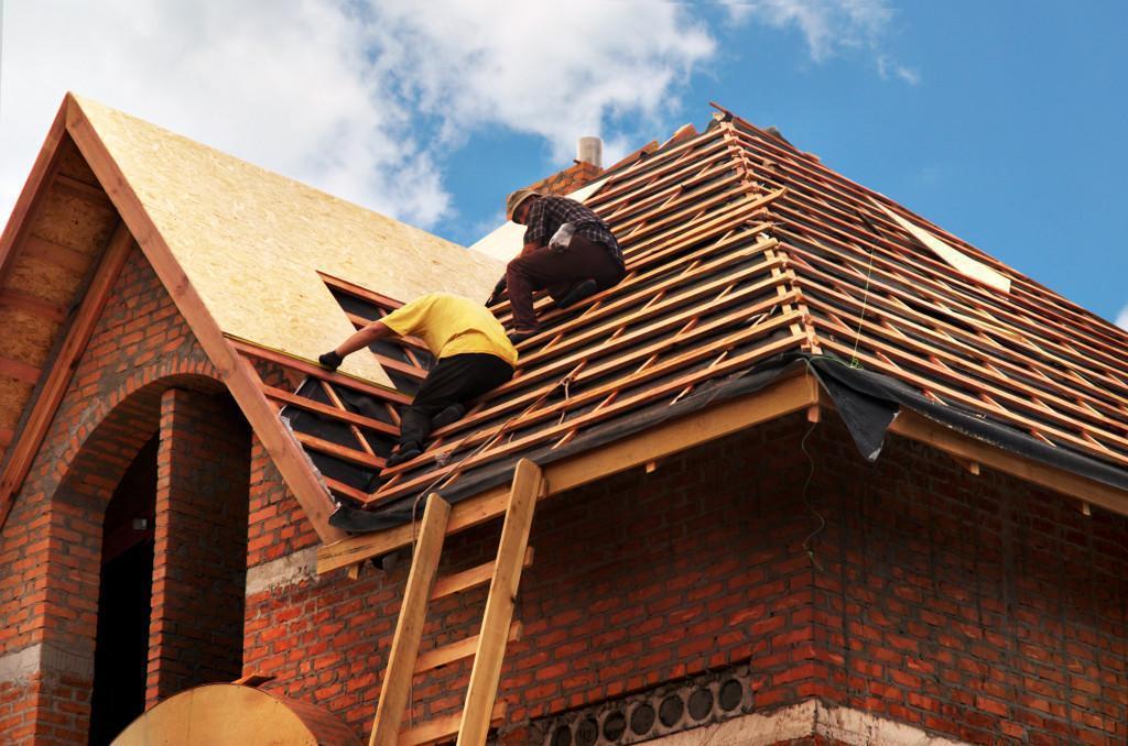 men building a house