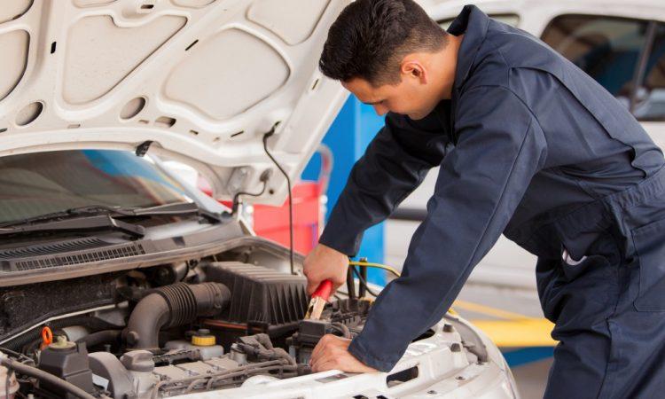 Mechanic doing some car tune up