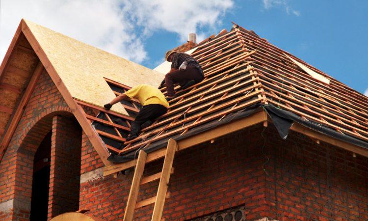 2 guys installing roof
