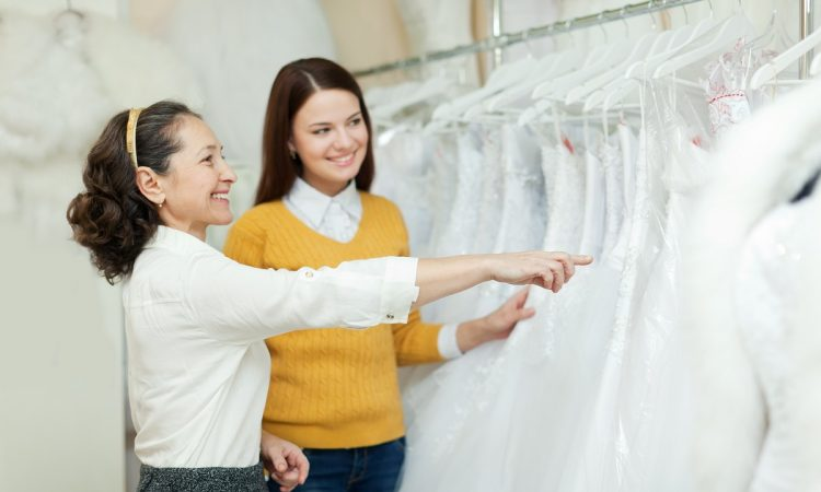 Female looking at bridal gowns