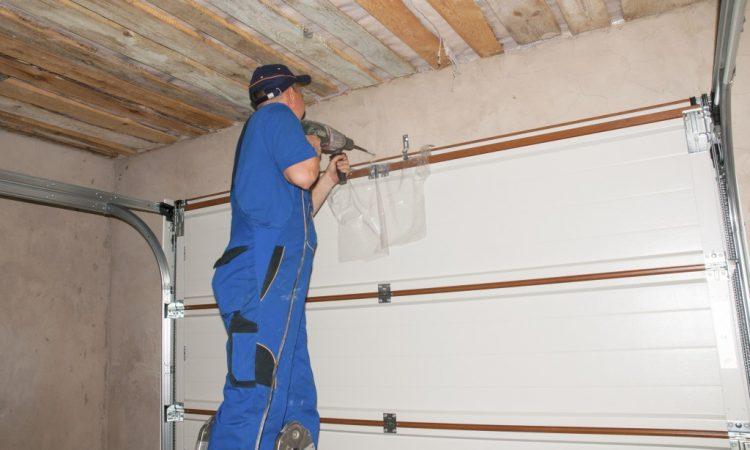 man improving garage door