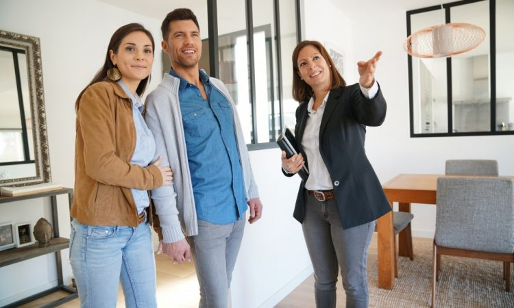 real estate agent touring a couple