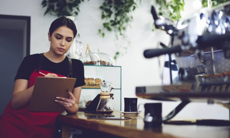 coffee shop owner checking her documents