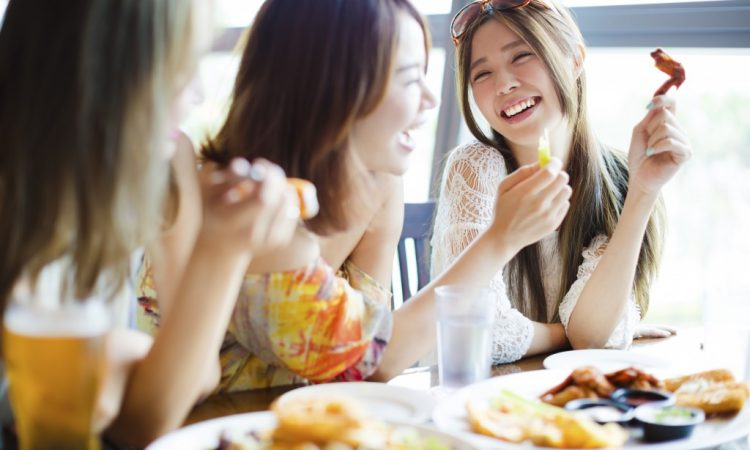 group of women eating in a restaurant