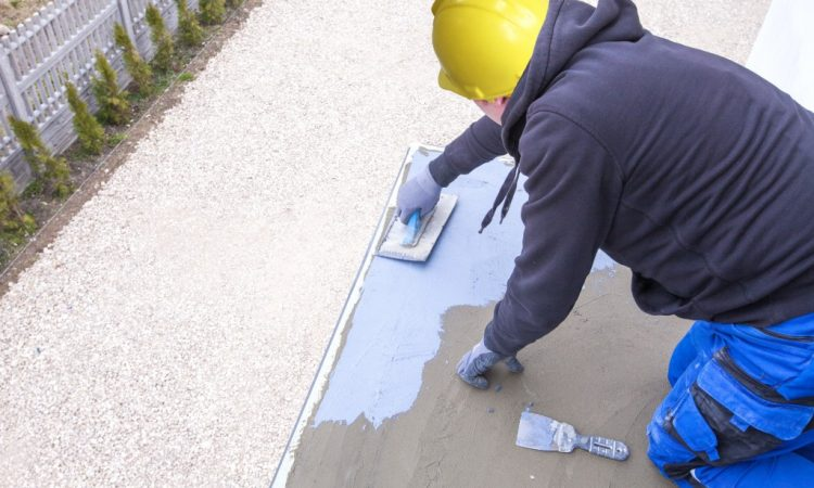 Construction worker applying sealant