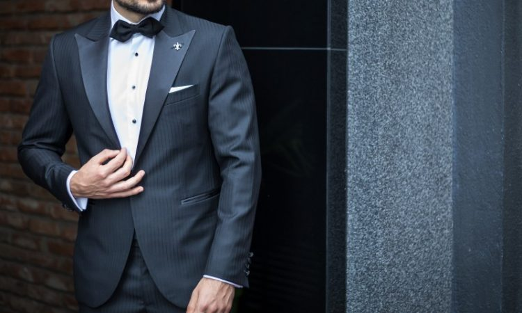 man in a suite with a bow