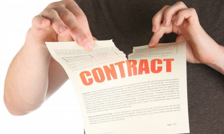 Person tearing a contract